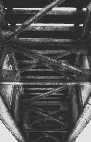 Following the train tracks from beneath their overpass is a joy to capture with photography. Black & White Black And White Train Tracks Overpass Railroad Ties Bridge Looking Up Underneath From My Point Of View From My Eyes To Yours Letgodhandleit Railway Contrast Rivets Urban Train Metal Structure Underpass Dramatic Tressel Contrast Shadows Dark Crisscross The Following The Secret Spaces