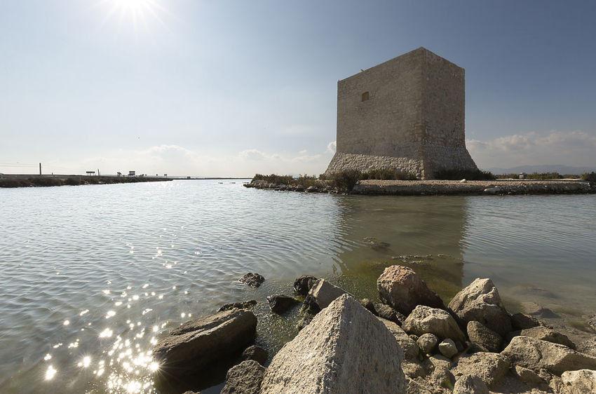 Tower of Tamarit in Santa Pola, province of Alicante, Spain. Alicante Coastline SPAIN Salinas Santa Pola Spanish Tamarit Architecture Built Structure Day Europe Landmark Landscape Natural Park Nature No People Outdoors Sky Sunlight Tower Water