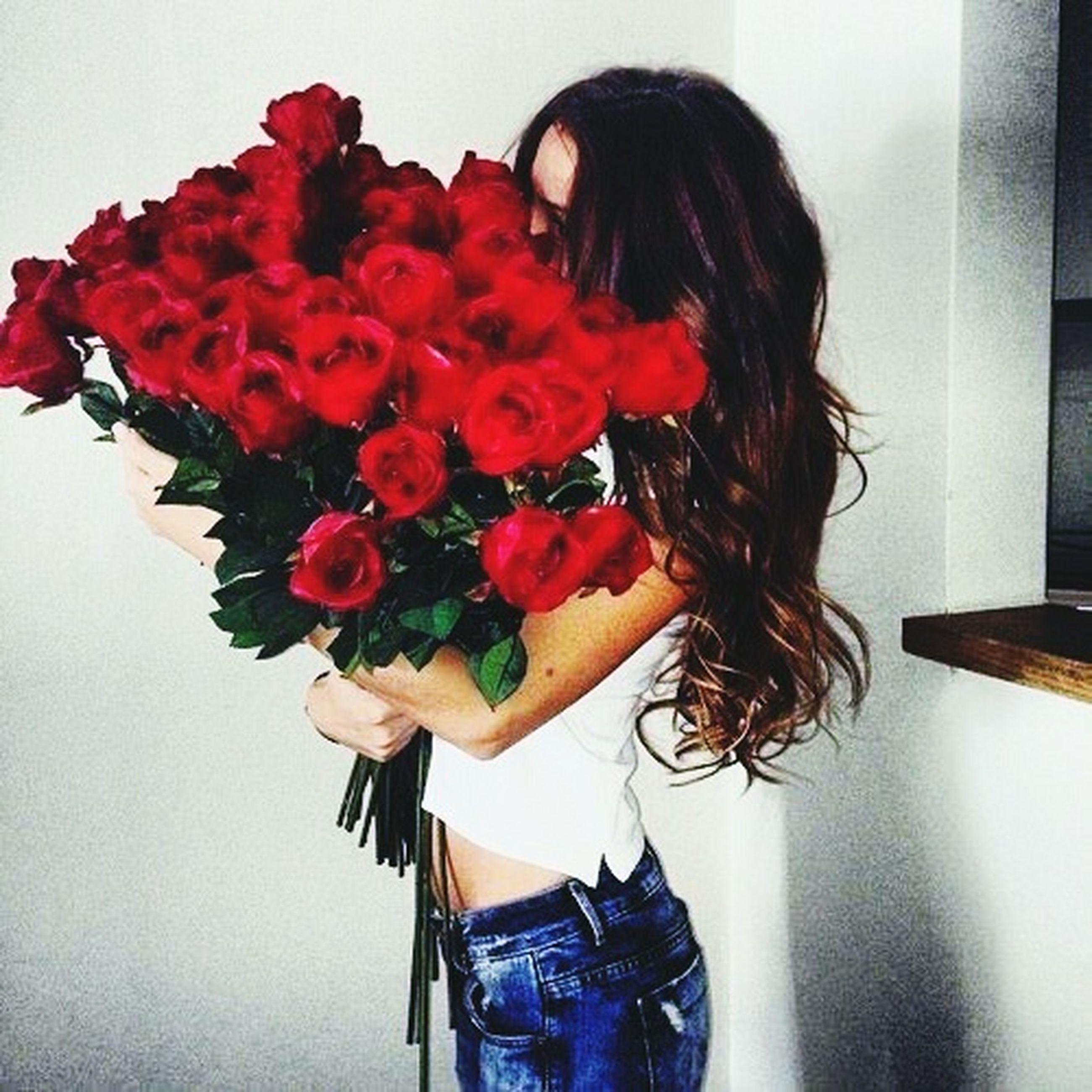 flower, rose - flower, red, fragility, freshness, bouquet, only women, holding, beauty, one person, one woman only, women, adults only, adult, beauty in nature, people, young adult, one young woman only, nature, flower head, human hand, day