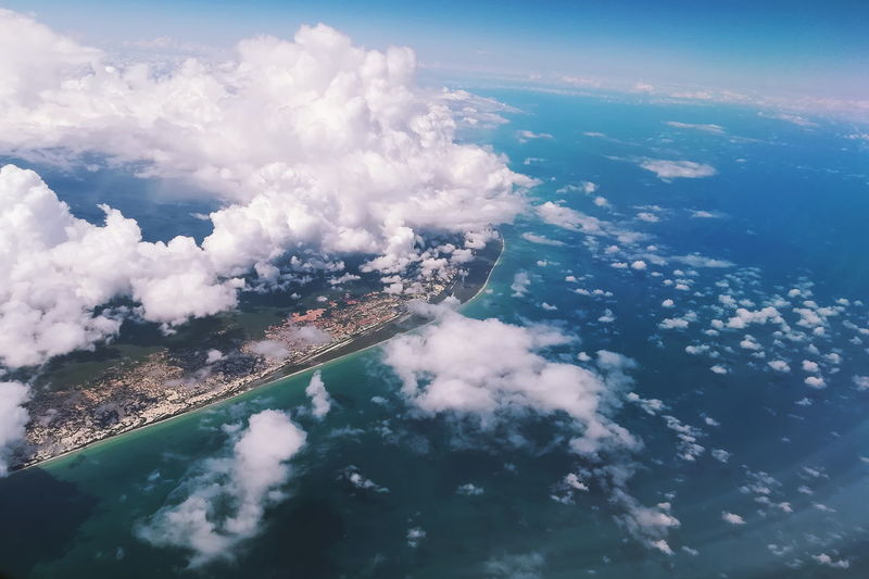 Aerial view of sea and landscape against sky