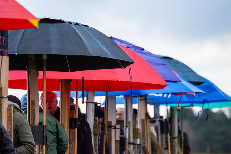 The bookmakers umbrellas at the point to point racing, Ampton, Suffolk The Bookies Race Course Horse Racing Horse Racecourse Umbrella Protection Sky Real People Incidental People Bookmakers Bookmakers Stalls Stalls Rain At The Races Point To Point Point To Pointing Point To Point Racing