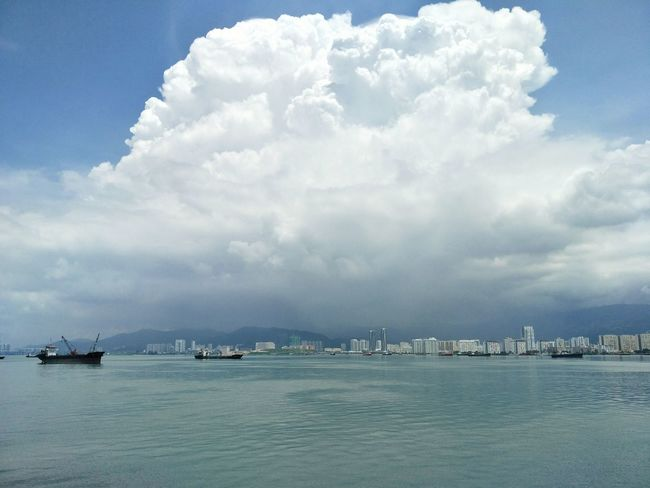 Sea Outdoors Cloud - Sky No People Day Tranquility Nautical Vessel Scenics Nature Water Sky City Beauty In Nature