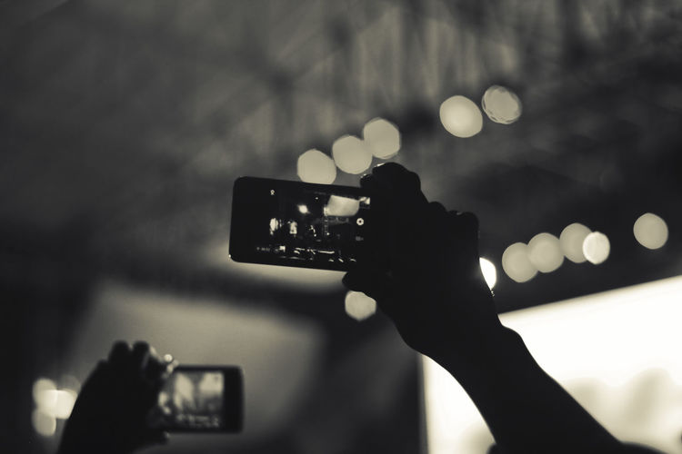Concert crowd filming with smartphone