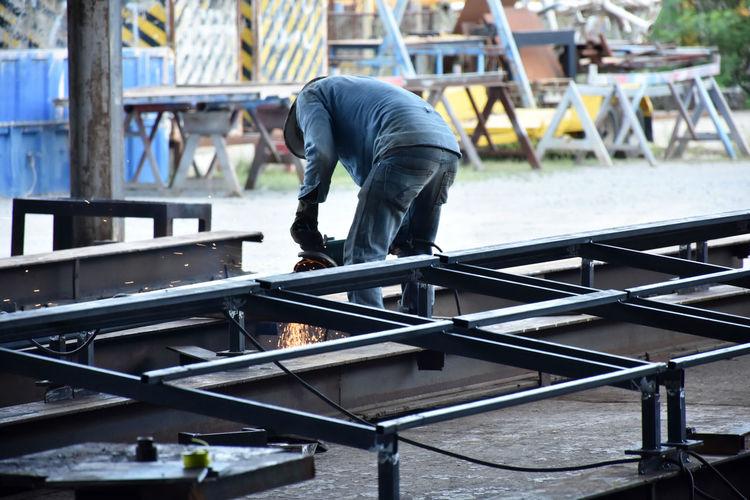 Man working on railing