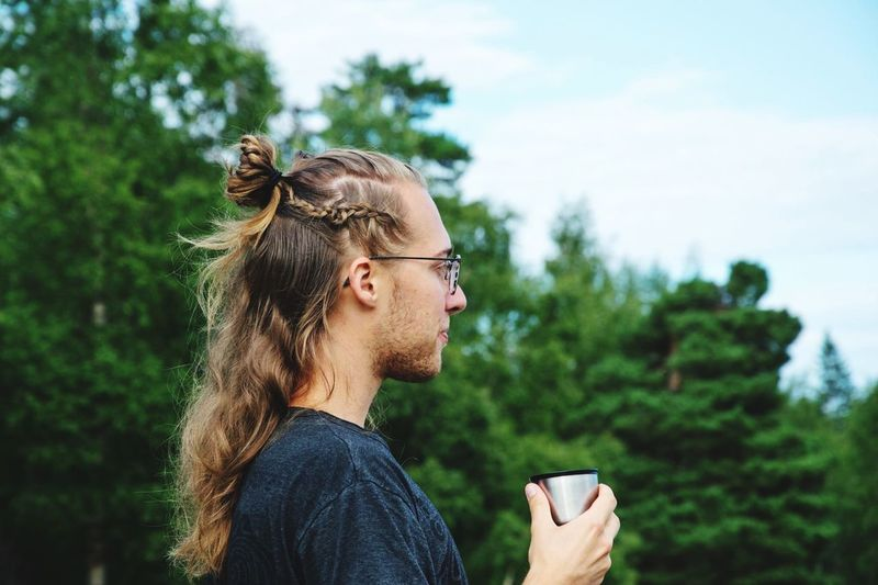 Mein Sohn Marcel EyeEm Selects One Person Lifestyles Glasses Side View Real People Leisure Activity Eyeglasses  Plant Tree Focus On Foreground Young Adult Day Nature Looking Wireless Technology Cup Headshot Young Men Looking Away Outdoors First Eyeem Photo