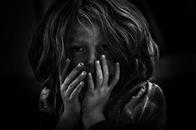beautiful b&w Black Background Human Hand Childhood Girls Shy Hands Covering Mouth Embarrassment Hiding Peeking Face Innocence HEAD Elementary Age