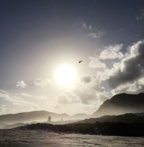 Mountain Flying Sky Nature Scenics Sun Outdoors Beauty In Nature Mountain Range No People Sea Helicopter 🚁 Walks On The Beach  Beach Travel Destinations Hermanus South Africa