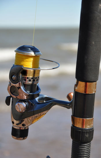 Close-up of metal pole against sea