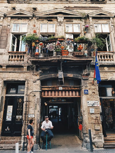 Alternative Budapest Budapest Budapest Streetphotography Szimpla Kert Streetphotography Street Photography Budapest, Hungary Adventures In The City Men Women Place Of Worship Architecture Building Exterior Built Structure Entryway Entrance Outside Gate
