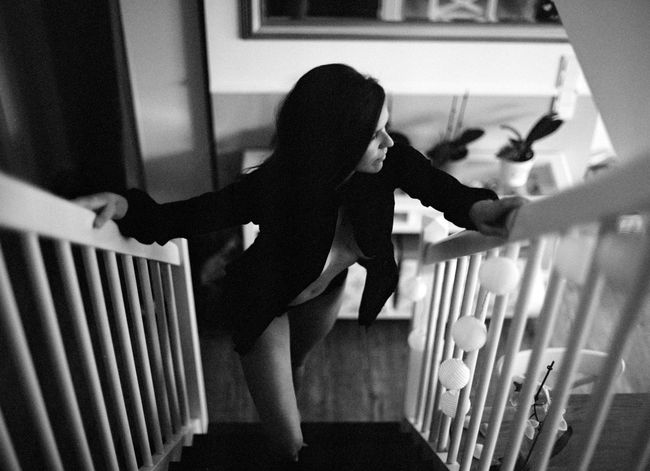 Adult Analog Blackandwhite Casual Clothing Clothing Crib Focus On Foreground Full Length Hairstyle Home Interior Indoors  Leg Leisure Activity Lifestyles Mediumformat One Person Railing Real People Staircase Standing Steps And Staircases Women Young Adult Young Women