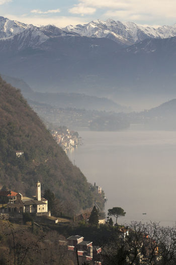 overlooking Lake Como, Italy Church Como Lake Europe Fog High Angle View Italy Lake Lake Como Landscape Misty Mountain Range No People Outdoors Overlook Scenery Scenics Tranquility Travel Destinations Vertical