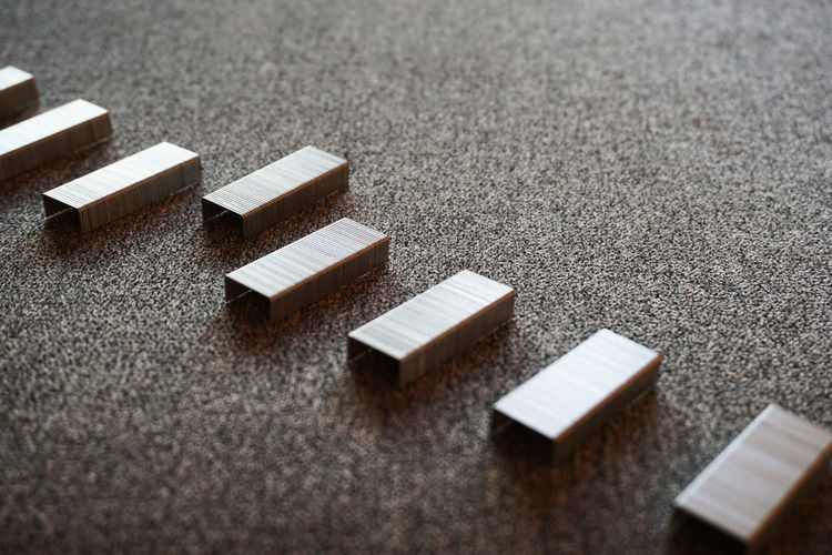 High angle view of stapler pins on table
