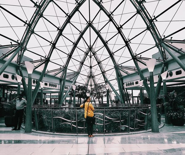 Breathing Space Rear View Futuristic Walking Full Length Passenger One Person Standing Adult Indoors  Modern Real People Adults Only People Men Day One Man Only Architecture Only Men Greenhouse Sky