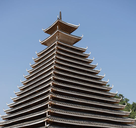 Bell Tower in Dong Village, Sanjiang, China Architecture ASIA Beauty In Nature Bell Tower Building Exterior Built Structure China Chinese, As Clear Sky Cultures Day Dong History Low Angle View No People Outdoors Pagoda Place Of Worship Religion Sanjiang Spirituality Tower Traditional Travel Destinations Village