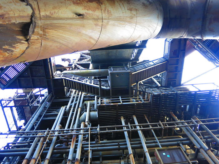 Low angle view of machinery at landschaftspark duisburg-nord