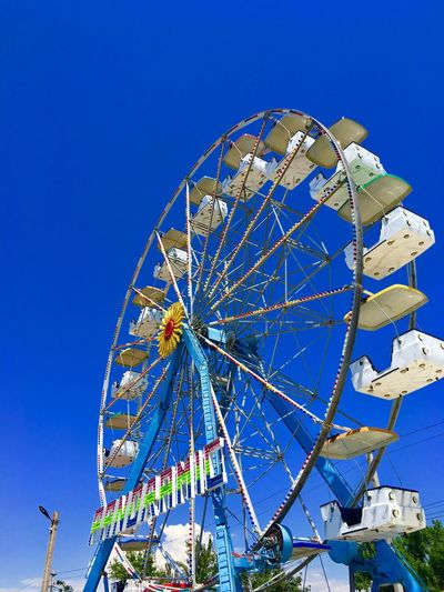Sky Blue Amusement Park Low Angle View Ferris Wheel Amusement Park Ride Clear Sky Outdoors No People Day Nature Arts Culture And Entertainment Geometric Shape Shape Sunlight Built Structure Pattern Large Circle Carnival