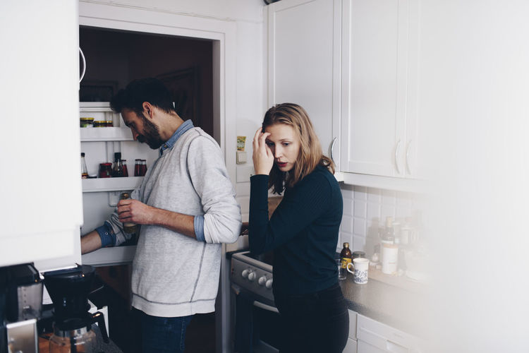 Man and woman standing at home