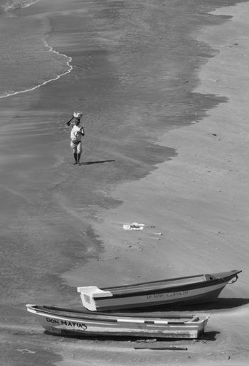 Aerial View Beach Bnw_captures Bnw_collection Bnw_life Colombia Colombia ♥  Day EyeEm Best Shots EyeEm Best Shots - Black + White High Angle View Men Nautical Vessel One Man Only One Person Only Men Outdoors People Real People Santa Marta, Colombia Sea Transportation Water Wave