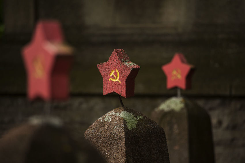 3 red stars with hammer and sickle on headstones on a graveyard for fallen russian soldiers Memorial Soldier Sovjet Monument Art And Craft Belief Built Structure Cemetery Close-up Cross Day Focus On Foreground Grave Graveyard Headstones In A Row Nature No People Outdoors Religion Russian Second World War Shape Solid Spirituality Stone Stone Material Tombstone World War II