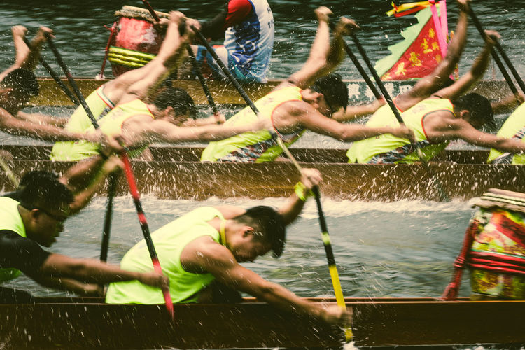 Motion Blur of Dragon boats racing Group Of People Real People Outdoors Lifestyles Day Motion Men Dragon Boats Dragon Boat Festival Hong Kong Blurred Background Blurred Motion Water Sports EyeEm Best Shots EyeEmNewHere Annual Paddle Racing Teamwork Traditional Festival Game Active Action Shot  Rowing Competition