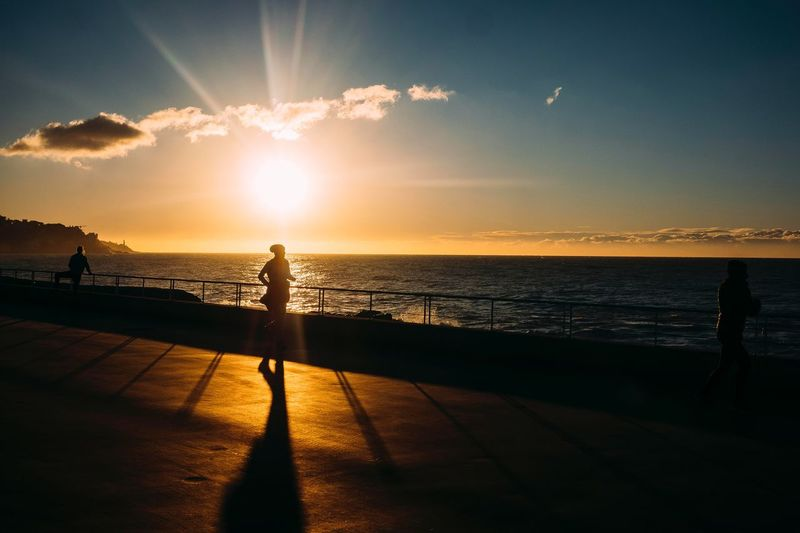 La joggeuse Promenade Des Anglais Nice Light Running Footing Sunrise Sport Runner Waterfront Sky Water Sea Sunset Sunlight Beauty In Nature Real People Sun Silhouette Horizon The Street Photographer - 2018 EyeEm Awards