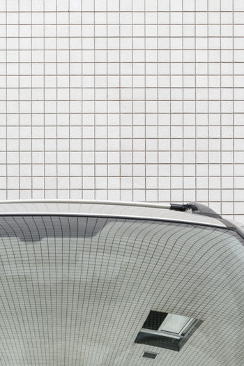 Cropped image of car against wall