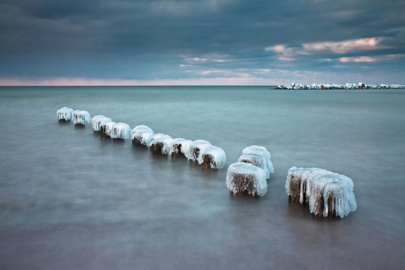 Winter on the Baltic Sea coast. Baltic Sea Beach Beauty In Nature Coast Day Fischland Frozen Groyne Ice Long Exposure Nature No People Outdoors Scenics Sea Shore Sky Tranquil Scene Tranquility Water Winter Wustrow