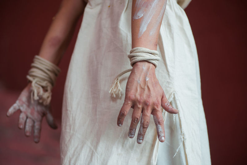 Midsection of woman hands covered with paint