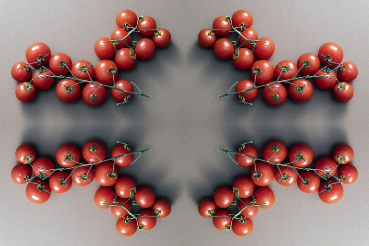 Food Food And Drink Healthy Eating Vegetable Indoors  Red Studio Shot Still Life Arrangement Wellbeing Directly Above Fruit Freshness Tomato No People Symmetry Cherry Tomato Large Group Of Objects Close-up Gray Background Order Digital Composite Vegetarian Food