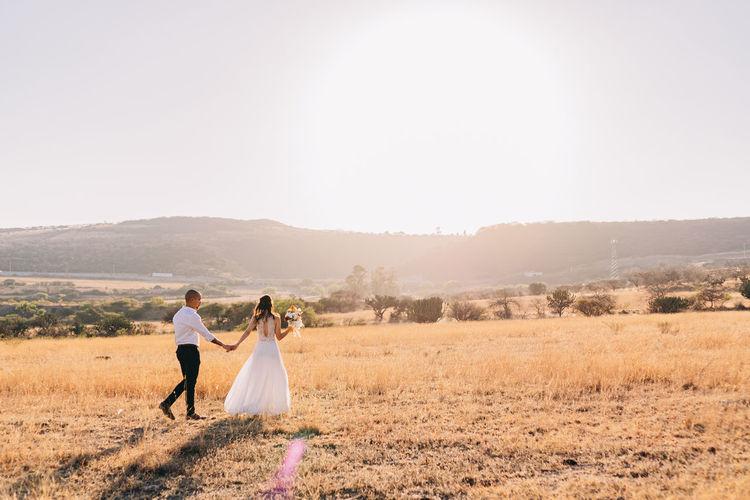 Couple walking on field