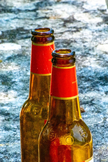 Close-up of beer glass bottle on table