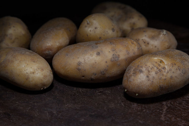 Close-up of potatoes against black background