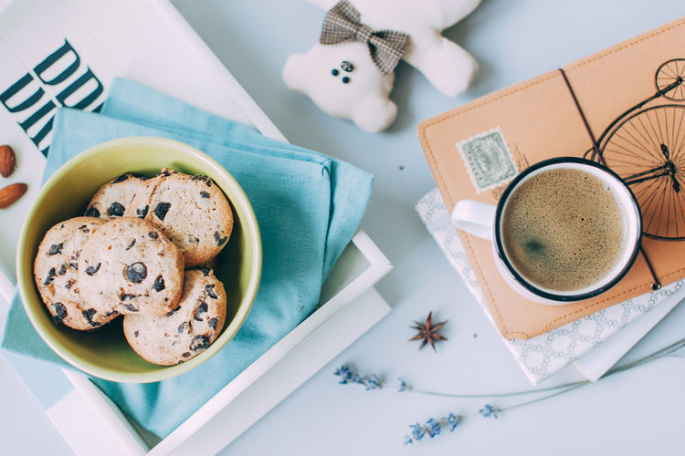 High angle view of coffee and cookies on table