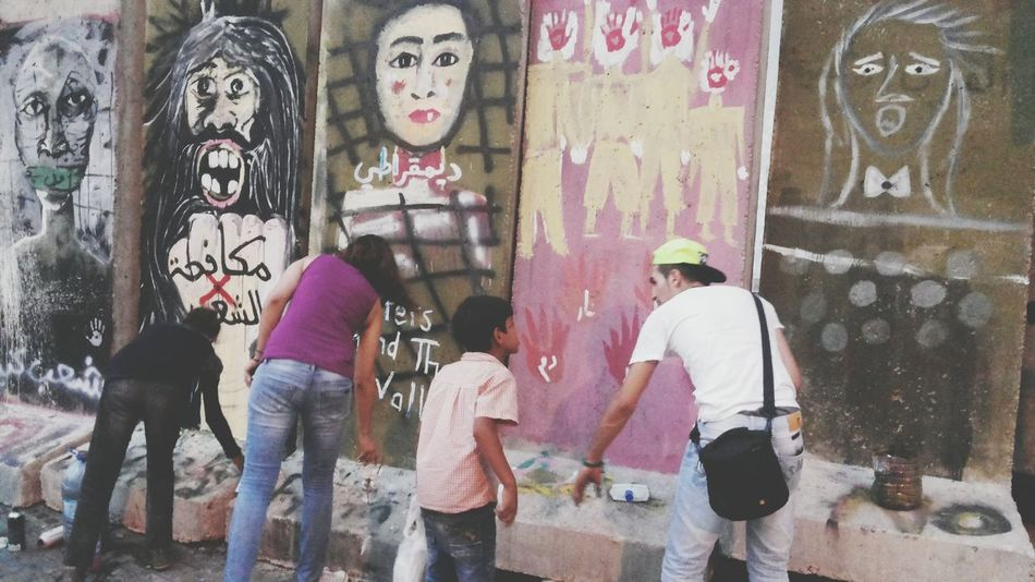 Capture The Moment painting the isolation wall between the Lebanese government and the people in beirut down town. Photography Photographer Thewall Eye4photography  My Country In A Photo