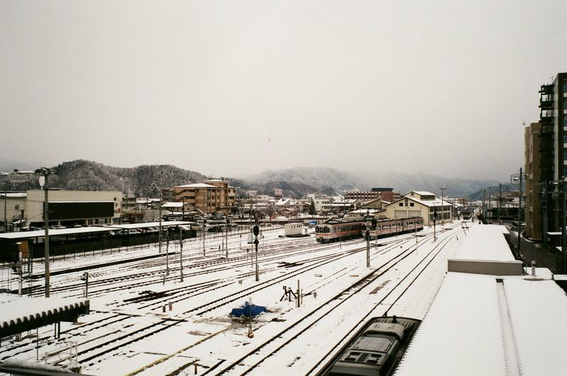 High angle view of railroad tracks against sky during winter