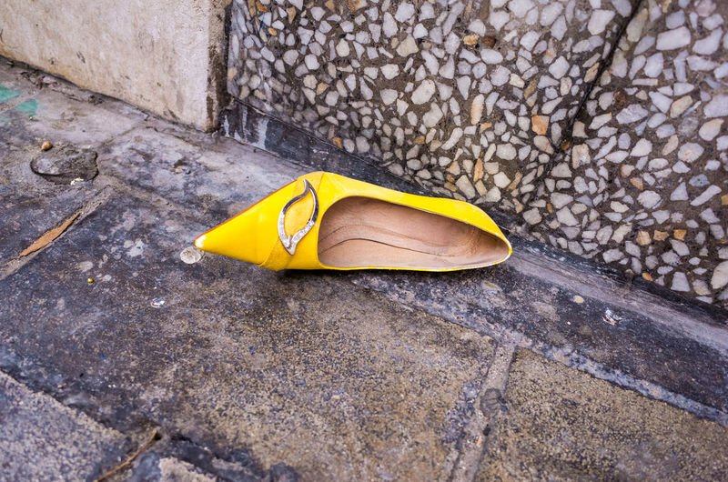 High Angle View Yellow Outdoors Street No People Close-up Shoe Shoes High Heel Shoes Lost Trash Lostandfound Trash Art Garbage Alone One Womensshoes Color Colour Streets Art Contemporary Contemporary Art Contemporaryart Lostshoe