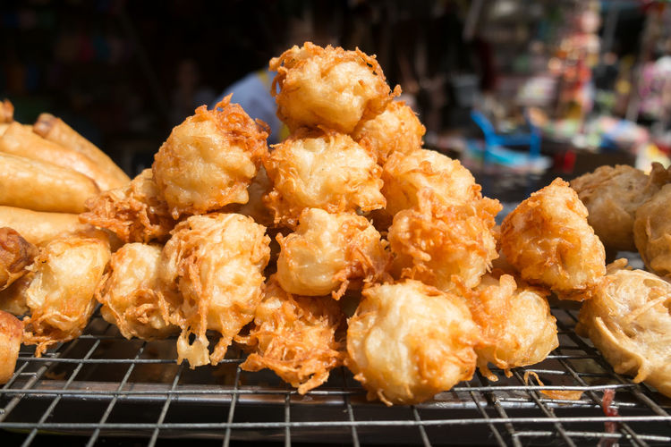 Fried taro for sale at a local market street food in bangkok, thailand.