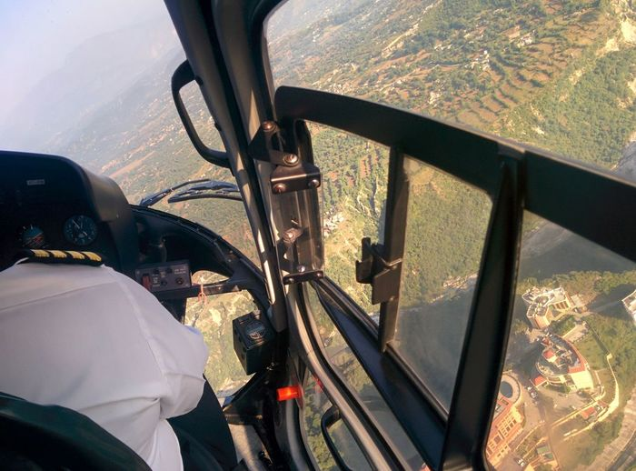 Close-up Day Flying Helicopter View  Journey Men Mode Of Transport Mountain Person Transportation Travel Vehicle Interior Window Passenger Seat Piloting Helicopter