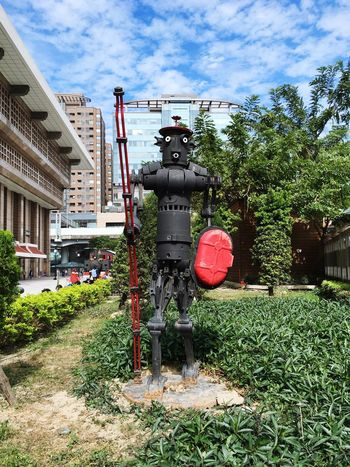 Robot statue Sky Architecture Outdoors Day Tree Building Exterior Station Cloud - Sky Grass City No People EyeEm Eyeemphotography EyeEm Gallery Outdoor Photography Landscape Urban Eyeemphoto Statue ArtWork Art Robot Metal