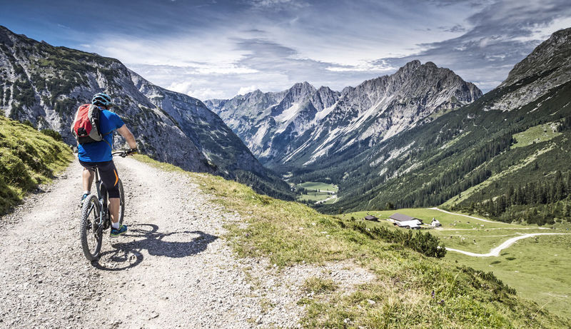 Mountainbiker with E-Bike at the Karwendel mountains Alps Austria Bavaria Bike E-bike Ebike Electric Bike Epic Fit Fitness Garmisch Germany Karwendel Karwendelgebirge Leisure Activity Man Mountain Mountains MTB Panorama Pedelec Tour Training View Werdenfels