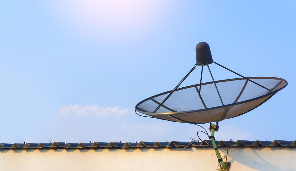 sattellite dish communication industry on roof with blue sky background Antenna - Aerial Architecture Blue Building Exterior Built Structure Communication Connection Day Global Communications Low Angle View Nature No People Outdoors Roof Satellite Satellite Dish Sky Technology Telecommunications Equipment Television Aerial