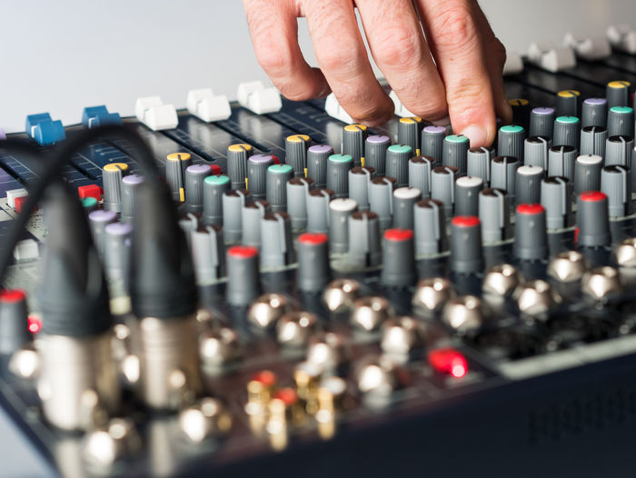 Close-up of man playing sound mixer