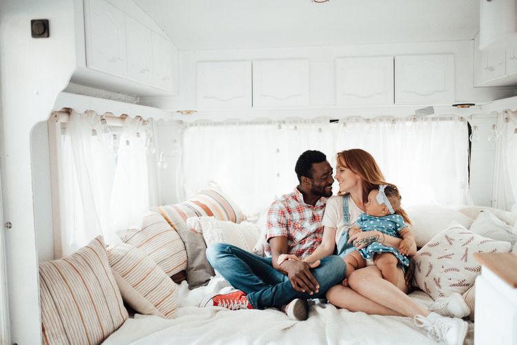Cheerful family siting in camper van