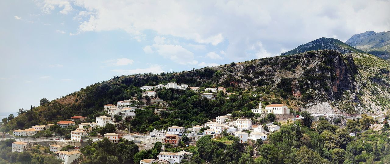 partial view of Village Dhërmi in South of Albania Church Monastery Houses Building Architecture Rural Travel Destinations Tourism Mountain Tree Sky Cloud - Sky Rocky Mountains Tranquil Scene Calm Tranquility Non-urban Scene Remote Countryside