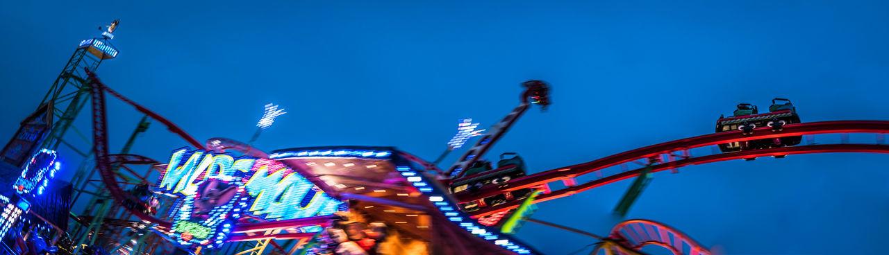 Rollercoaster WILDE MAUS / Hamburg DOM DOM2018 Feast Heiligengeistfeld Late Afternoon Lights Motion Blur Rollercoaster Wilde Maus Blue Blue Sky Festival Illumination Motion Move Movement Roller Coaster Speed Speedwagon