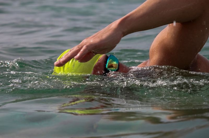 Ocean Summer Sport Swimming Goggles Open Water Swimming TRIATHLON Water Human Body Part Real People One Person Human Hand Hand Lifestyles Leisure Activity Nature Sea Motion
