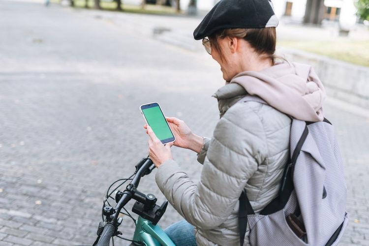 Man using mobile phone on street