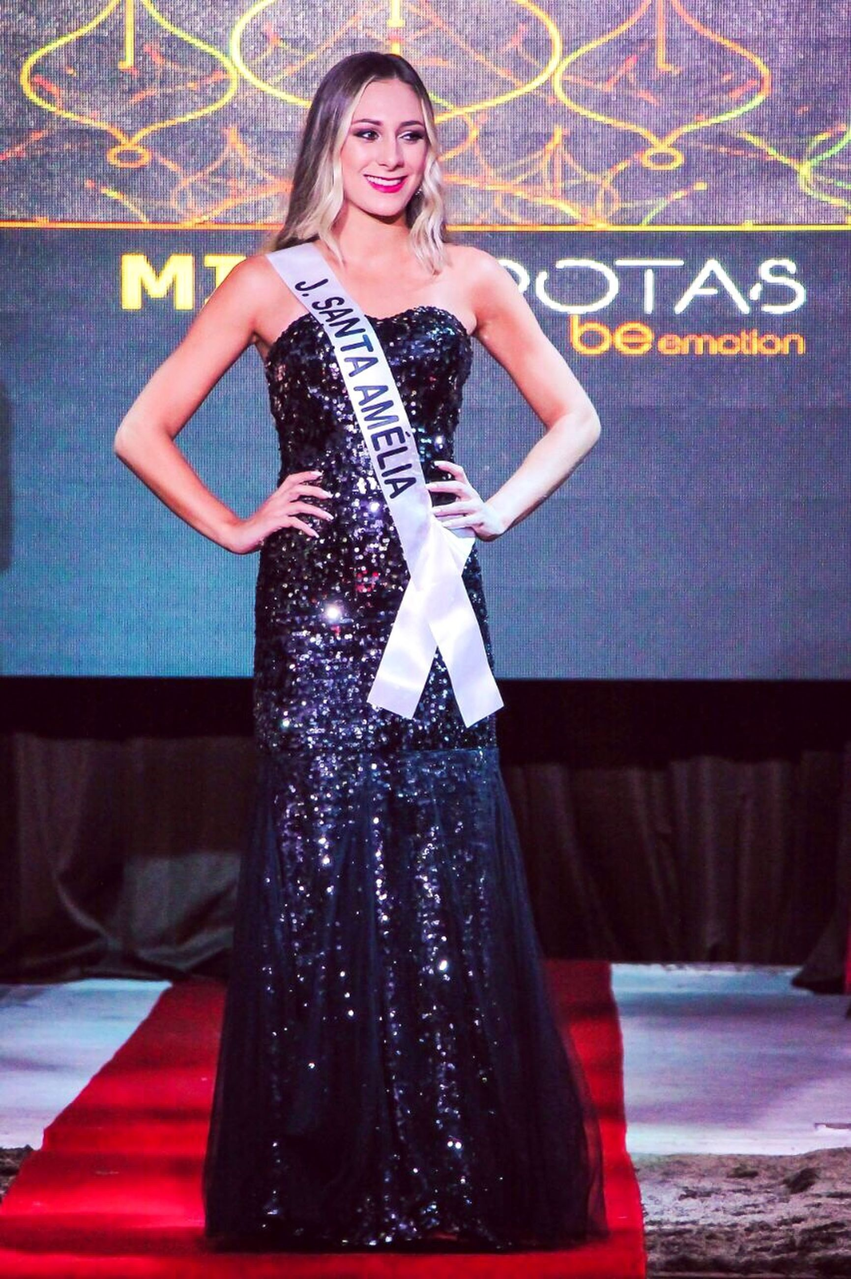 looking at camera, full length, portrait, one person, fashion, beautiful people, one woman only, beauty, confidence, young adult, people, indoors, adults only, glamour, luxury, beautiful woman, one young woman only, adult, only women, smiling, millionnaire, performing arts event, evening gown, day