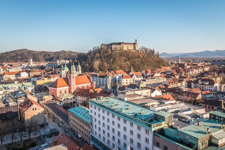 Ljubjana Castle in Slovenia Ljubljana Ljubljana, Slovenia Slovenia Building Exterior Architecture Built Structure City Residential District Building Sky Crowd Crowded Community Cityscape Day Nature Town High Angle View Clear Sky House Mountain Sunlight Roof Outdoors TOWNSCAPE Settlement