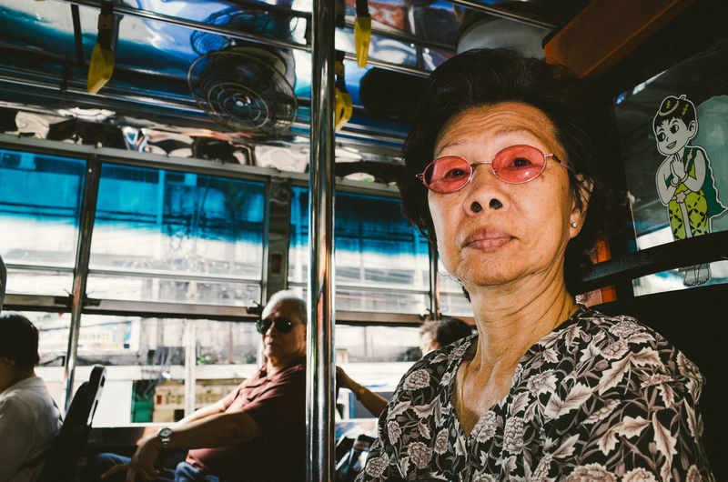 Portrait of woman with people in bus